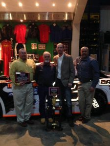 Trey Bright of Coker, AL (second from right) celebrates his 2014 NeSmith Performance Parts Street Stock Division Championship with his crew that include the 2014 NeSmith Performance Parts Street Stock Division Crew Chief of the Year Jonathan Thomas (far left) during the NeSmith Racing Annual Awards Banquet on Saturday night at the Georgia Racing Hall of Fame in Dawsonville, GA.  (Photo Courtesy of Trey Bright)