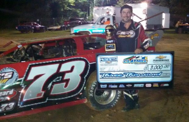 Ashley Newman of Ripley, TN celebrates next to his #73 Greg's Sawmill Special and hoists the Gold Helmet Trophy after a $3,000 victory in the No Till 50 for the NeSmith Chevrolet Dirt Late Model Series on Saturday night at Clayhill Motorsports in Atwood, TN.  (NeSmith Racing Photo)