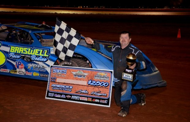 Rodgerick Dykes of Smith Station, Al celebrates his first NeSmith Late Model career win on Sunday night in night two of the East Coast Battle Royal at Golden Isle Speedway in Brunswick, GA driving the Braswell Bodies Warrior.  Dykes became the fifth different NeSmith Late Model winner in the first five races of the 2015 season.  (Troy Bregy Photo)