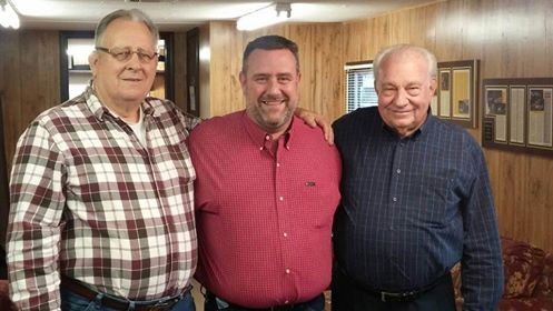 """NeSmith Racing Founder and CEO Mike Vaughn reminisces with lifelong friends 2015 National Dirt Late Model Hall of Fame Inductee Leon """"Slick"""" Sells on the left and Brad Hendricks on the right.  The National Dirt Late Model Hall of Fame has announced that Vaughn will introduce his boyhood hero Sells at the 2015 Induction Ceremony on August 8 at the Hall located on the grounds of Florence Speedway in Walton, KY.  (Adam Stewart Photo)"""