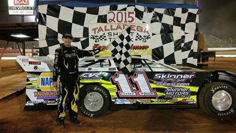 Sunoco Young Guns Challenge Series point leader Cruz Skinner of Oxford, AL celebrates his fourth NeSmith Chevrolet Weekly Racing Series win of the 2015 season in the Skinner's Body Shop CVR on Saturday night at Talladega Short Track in Eastaboga, AL.  The 13-year-old driver also moved up to seventh in the NeSmith Chevrolet Weekly Racing Series National point standings.  (TST Photo)