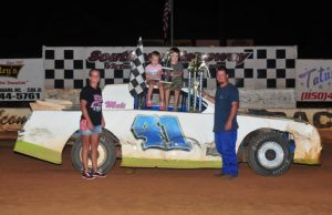 Brandon Kilpatrick of Jay, FL has been on a hot streak in NeSmith/AR Bodies Street Stock Division competition in recent weeks.  Kilpatrick celebrates with his family after winning the NeSmith/AR Bodies Street Stock Division feature race last Saturday night at Southern Raceway in Milton, FL.  In the last four weeks, Kilpatrick has driven the Kilpatrick Racing Chevrolet to two wins and two third-place finishes.  (Photo By Phil)