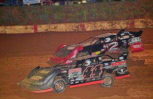DOUBLE DIPPERS – As the NeSmith Chevrolet Dirt Late Model Series heads for Rounds 16 and 17 of the 2015 season for a pair of 50-lap $2,500-to-win races this Friday night and Saturday night at Kentucky Lake Motor Speedway in Calvert City, KY, no one single driver has been a dominant force, and close competition has been the status quo for series.  Only John Ownbey of Cleveland, TN, shown here in the #44 Auto Depot Special, and Ryan King of Seymour, TN have won two races, and they were consecutive.  If Ownbey, King, or another driver can pull that trick off this Friday night and Saturday night at Kentucky Lake Motor Speedway, they will pick up a $1,000 Bonus for a $6,000 weekend payday.  There have been 13 different drivers to set fast time this season with only two drivers taking that honor twice.  They are Matt Henderson of Loudon, TN, shown here in the #H2 Duayne Hommel Tribute Car Rebel Diesel Rocket, and King shown here in the #30 Brian King Roofing Stinger.  (NeSmith Media Photo)