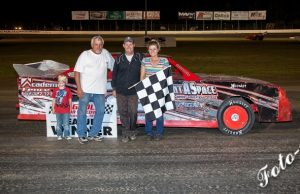 "Lee Ray of Columbus, MS warned up for the Twin $1,000-to-win NeSmith Performance Parts Street Stock Division races this Saturday night and Sunday night at Magnolia Motor Speedway in Columbus, MS with a win on the ""Black Ice"" last Saturday night in the #2 Rent-A-Space Chevrolet powered by a $3,495 Chevrolet Performance 602 Circle Track Engine.  It's going to be a busy Week 24 for the NeSmith Performance Parts Street Stock Division competitors with three chances to earn points on Friday, Saturday and Sunday, plus get a head start on Week 25 with a Monday race.  The Labor Day Holiday Weekend marks the beginning of the homestretch run in the final four weeks of the 2015 season.  (Foto 1 Photo)"